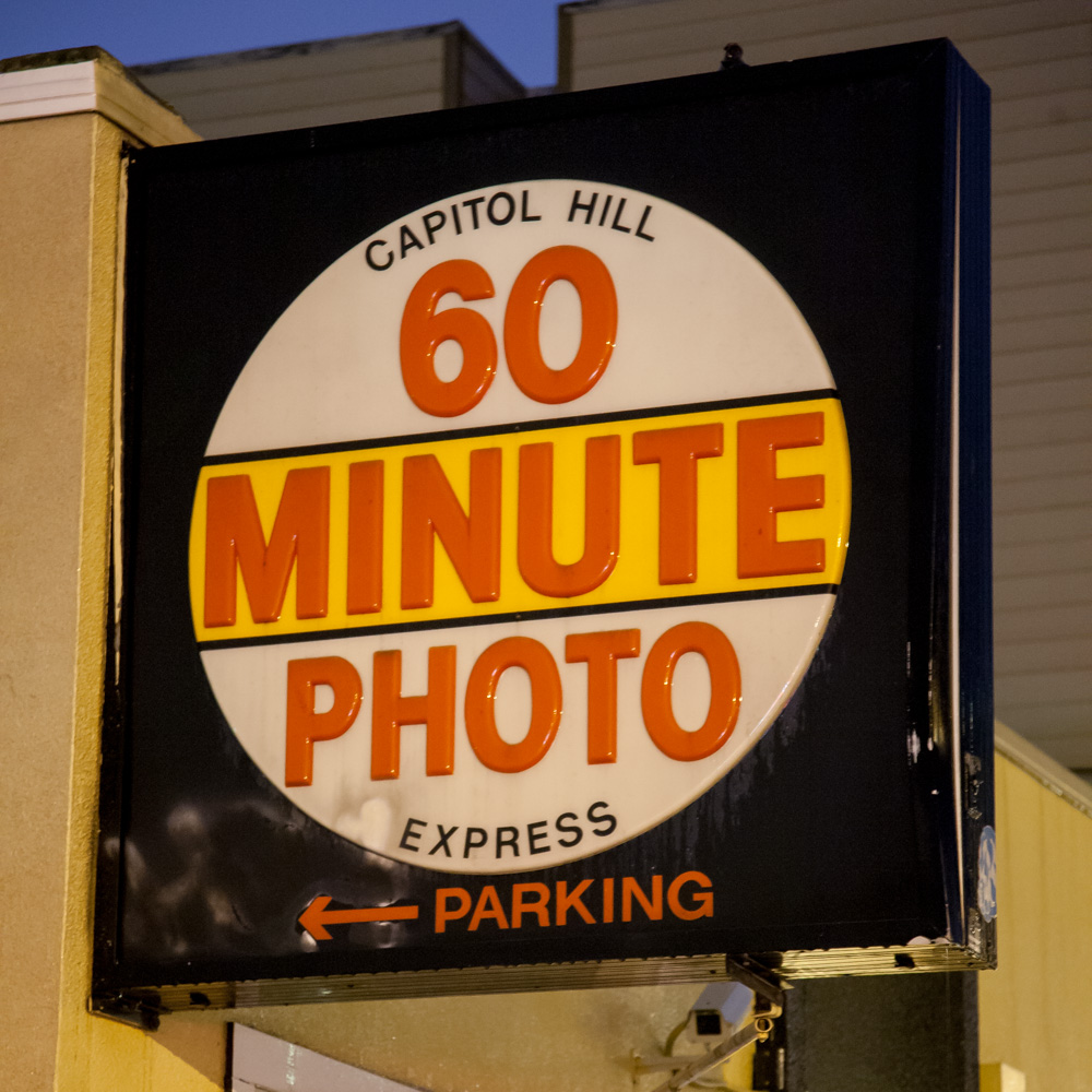 This is the sign on the corner outside 60 Minute Photo